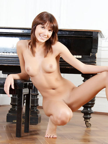 Absolutely Naked And Hot Teen Nata Is Performing Erotic Positions On The Piano